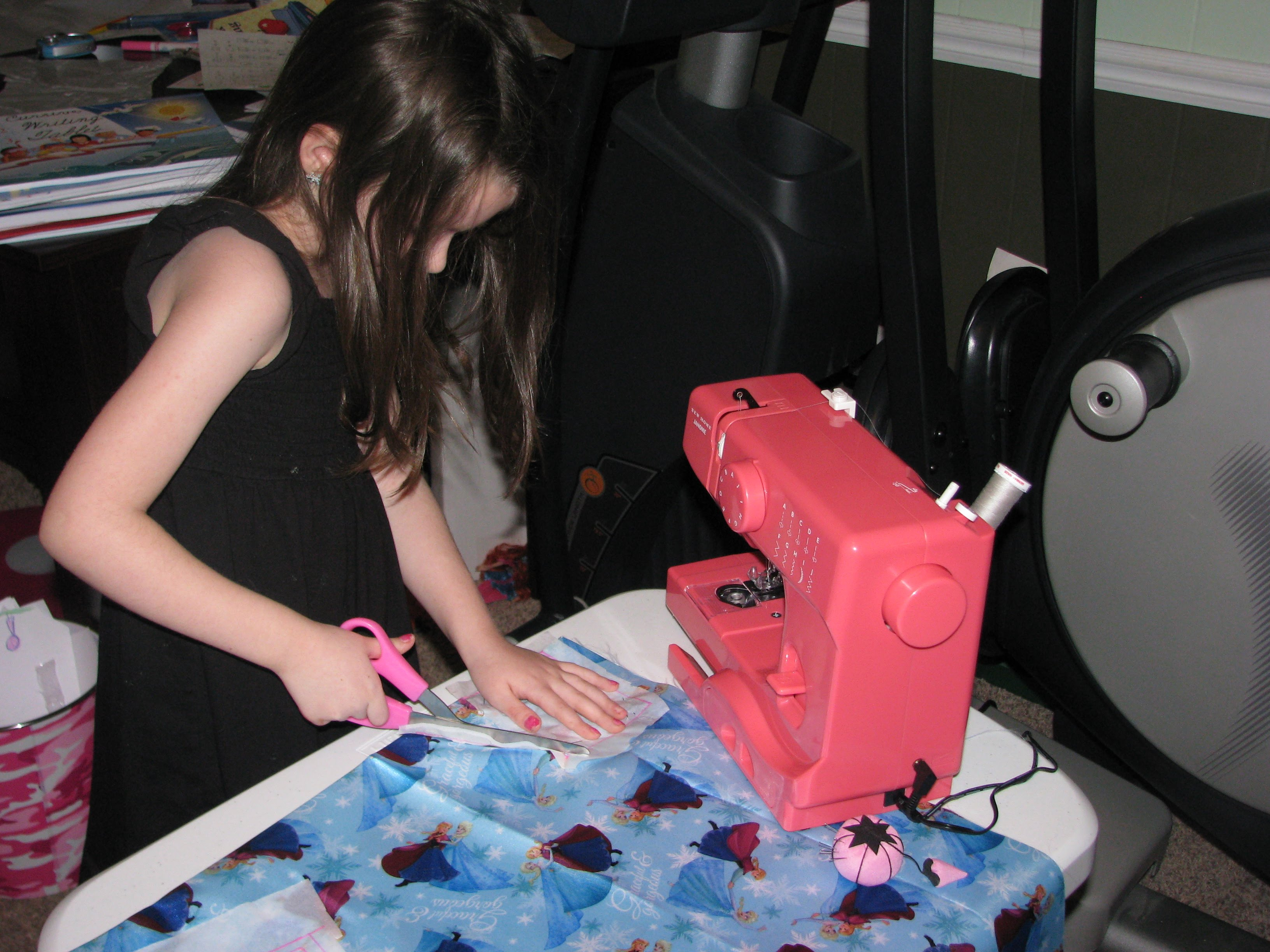 Here my daughter is cutting the fabric for her camera bag.